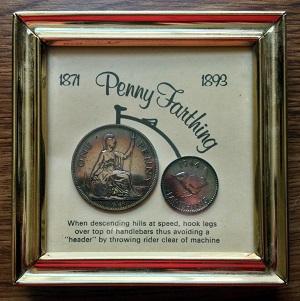 ペニー・ファージング銅貨と自転車